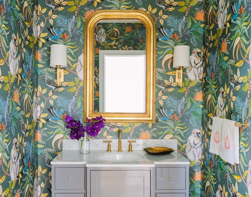 Bathroom with tropical wallpaper featuring leaves, birds, and monkeys, by Sarah Vaile Design (@sarahvailedesign) on Instagram