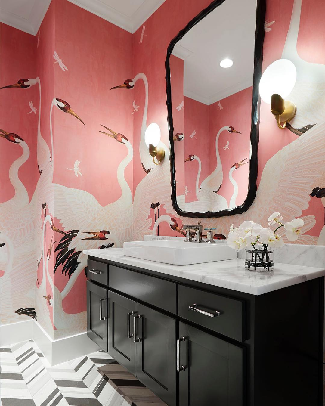 Bathroom with large scale coral wallpaper featuring white cranes and dragonflies, by Tracy Hardenburg Design (@tracyhardenburgdesigns) on Instagram