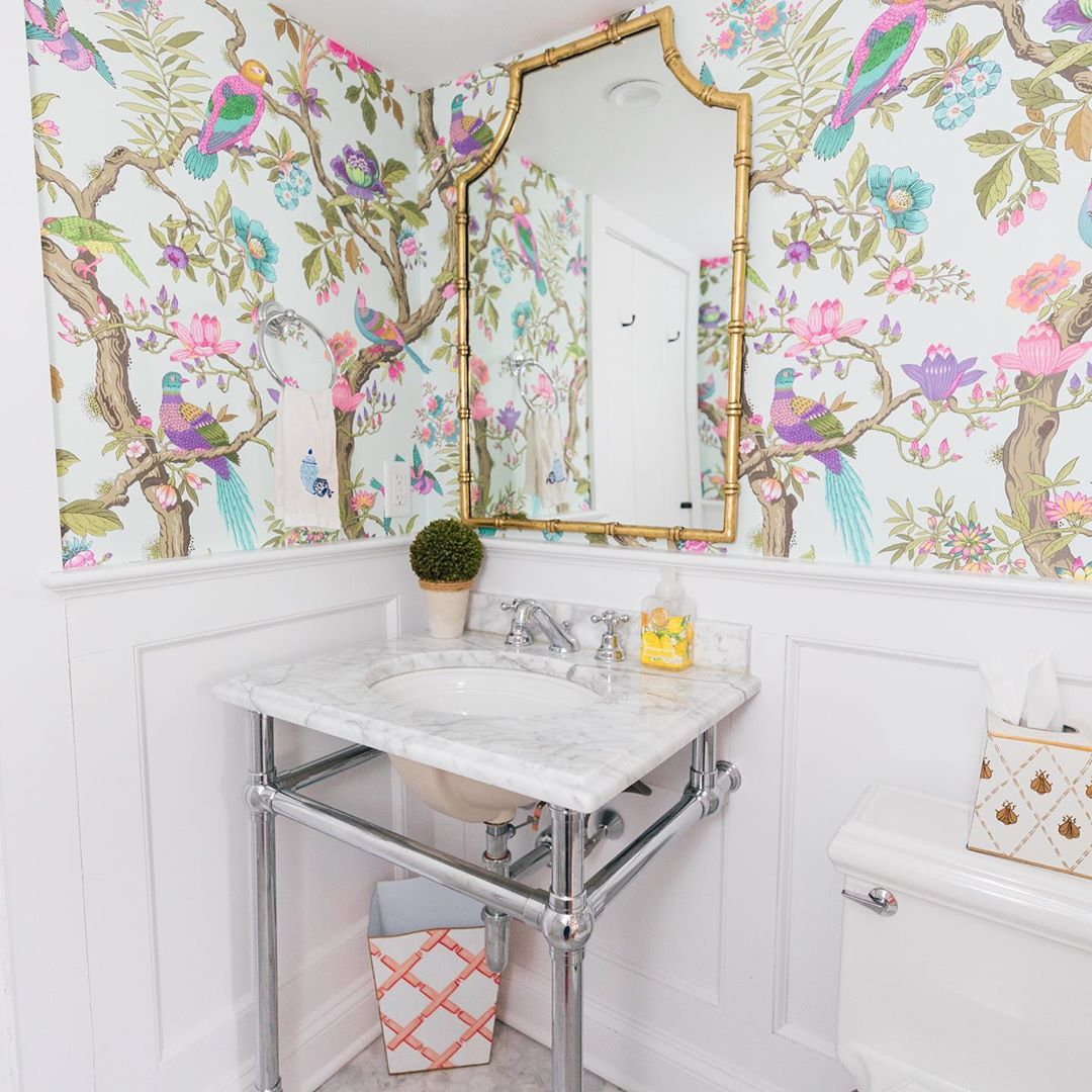 Bathroom with colorful bird and trees wallpaper on white background, from Diana Rose Spier (@dianarosespier) on Instagram
